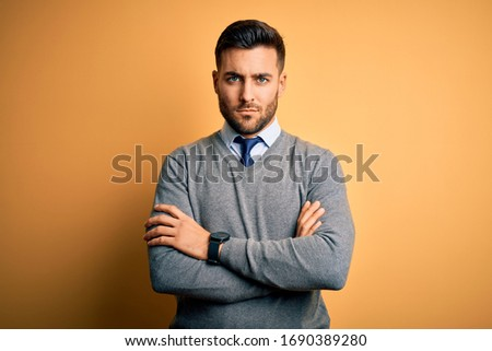 Portrait of a doubtful businessman with the arms crossed against a white background Stock photo © wavebreak_media