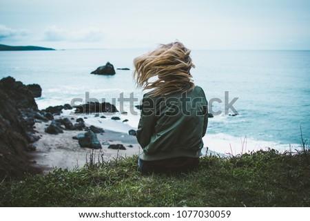 jovem · bela · mulher · sessão · azul · mar · ventoso - foto stock © rosipro