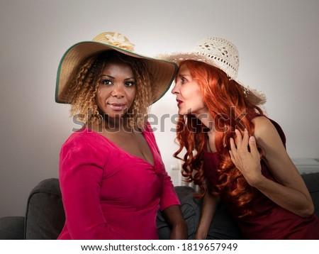 beautiful redhead woman in black, hat and jewels stock photo © lunamarina