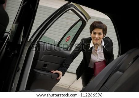 деловой женщины путешественник такси такси транспорт женщина улыбается Сток-фото © cboswell
