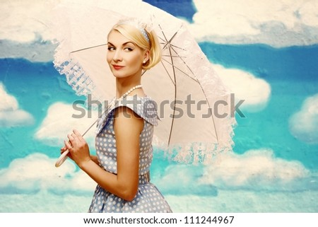 Stock photo: Blond coquette pin up style young woman in blue dress with vintage camera
