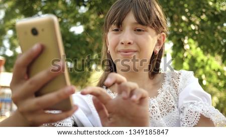 Woman texting message on smartphone, sunshine through the window Stock photo © stevanovicigor