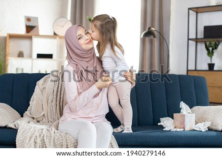 Happy Arabic family having fun time, mom and baby stock photo © zurijeta