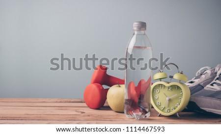 clock exercise on wooden table stock photo © fuzzbones0
