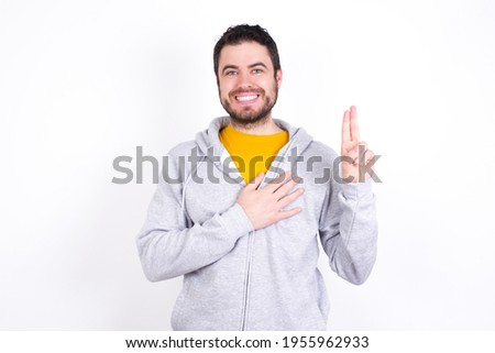 young business man in solemn pose with hand on chest Stock photo © feedough