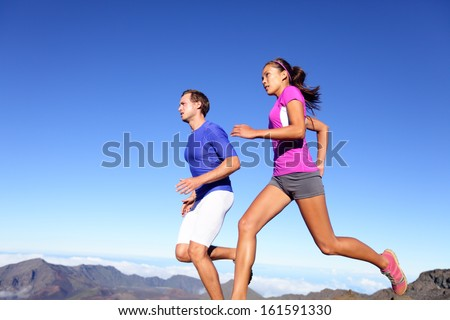 Young sports athletes couple sprinting as part of healthy lifestyle Stock photo © deandrobot