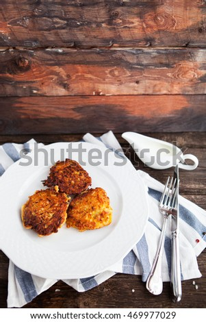 hash brown potato cakes with creamy sauce on a wooden background Stock photo © Yatsenko