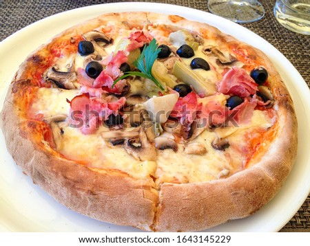 Homemade Pizza with tomato sauce, artichoke hearts, olives, Parm Stock photo © Yatsenko