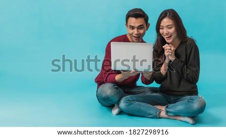 Kettő derűs lányok ül padló együtt Stock fotó © deandrobot