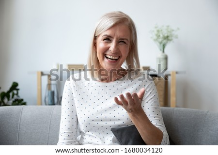 Close up portrait of satisfied woman, smiling and holding palms  Stock photo © deandrobot