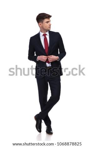 üzletember lábak keresztbe öltöny külső oldal áll Stock fotó © feedough