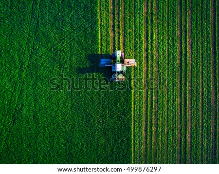 Aerial view the work of the tractor in the field in the spring. Photo from the drone Stock photo © artjazz