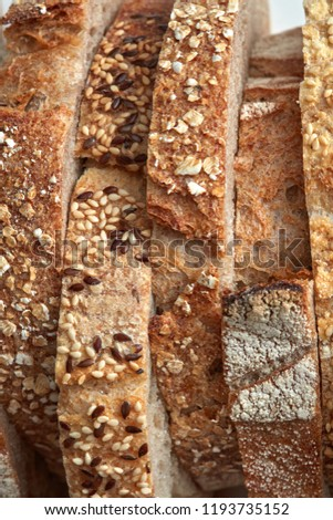Macro photo of different pieces of fresh bread with flax seeds a Stock photo © artjazz
