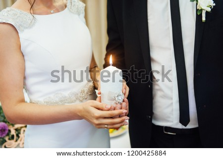 Candle in the hands of the newlyweds symbolizes hearth and well-being of the family Stock photo © ruslanshramko