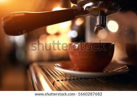 Macro photo of making fresh espresso coffee in a coffee machine. Breakfast Stock photo © artjazz