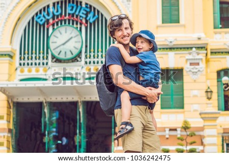 father and son on background saigon central post office on blue sky background in ho chi minh vietn stock photo © galitskaya