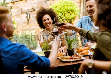 Cheerful young people have lunch in the courtyard and have fun Stock photo © boggy