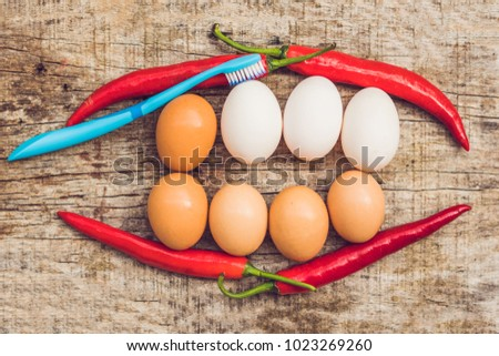 eggs and red peppers in the form of a mouth with teeth leaves are stuck to the teeth and dental flo stock photo © galitskaya