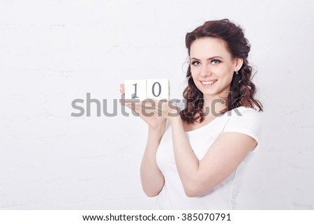 casually dressed woman hold number one sign and shows thumbs up Stock photo © feedough