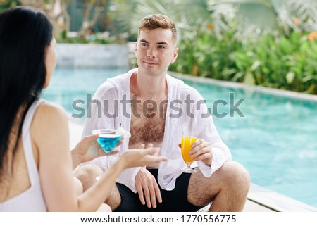 Young restful female with drink spending time in swimming-pool Stock photo © pressmaster