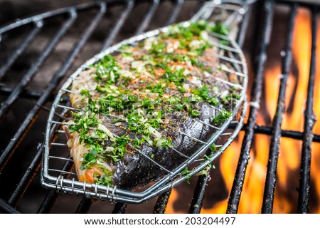 Barbecue outdoors with grilled fish Stock photo © Alex9500