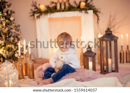 Cute boy hugs his favorite toy that he was presented with for the New Year Stock photo © ElenaBatkova