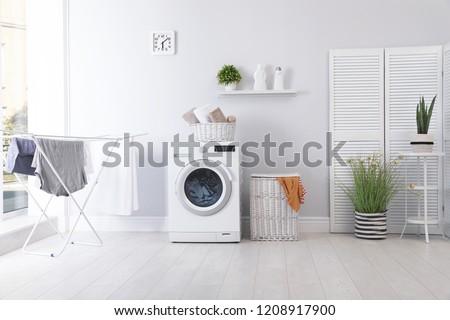 Lavandería habitación lavadora sucia ropa cesta Foto stock © vkstudio