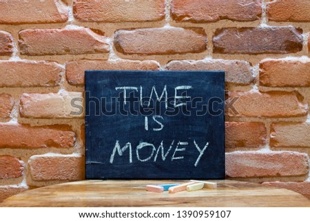 Black board with the phrase 'Time is Money' drown by hand on woo Stock photo © marylooo