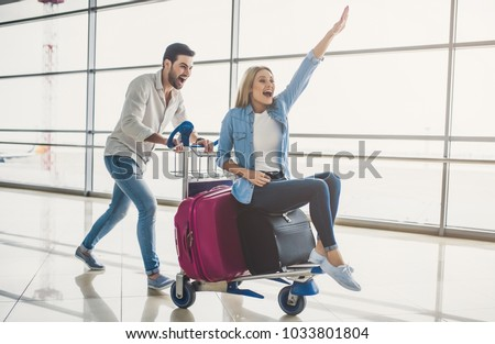 Happy female and male travellers with bags and modern technologi Stock photo © vkstudio