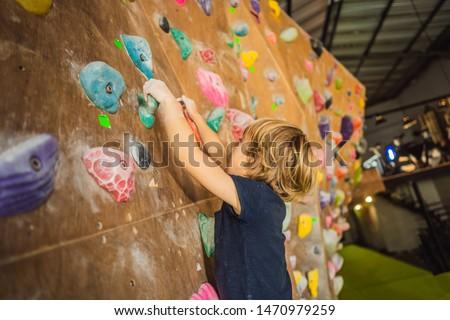 little boy climbing a rock wall in special boots. indoor BANNER, LONG FORMAT Stock photo © galitskaya