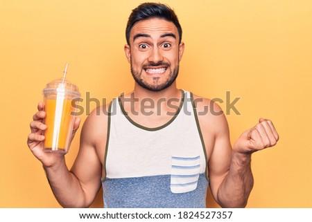 Gioioso eccitato giovani bell'uomo arancione tshirt Foto d'archivio © benzoix