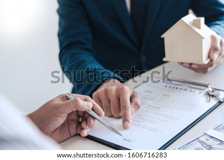 Real estate agents explain the document for customers who come t Stock photo © snowing