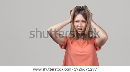 Image of stressed adult woman screaming and grabbing her head Stock photo © deandrobot