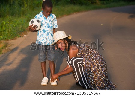 young beautiful woman holding soccer ball pulling on her football shirt stock photo © rob_stark