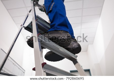 Handyman with step-ladder Stock photo © photography33