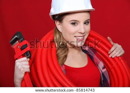 Stockfoto: Vrouwelijke · bouwvakker · buizen · pijp · sleutel