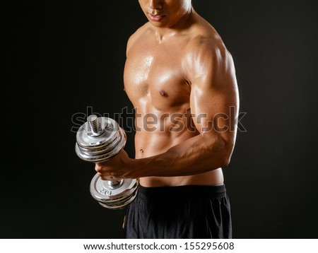 Asian man doing a bicep curl Stock photo © sumners