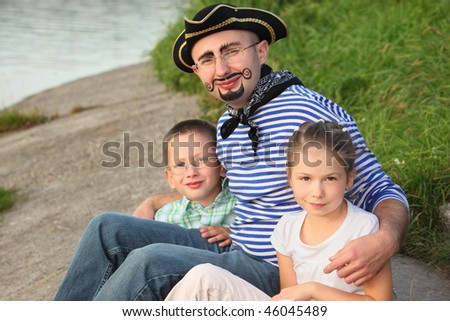 Man in pirate suit with his son and daughter near pond in early fall park Stock photo © Paha_L