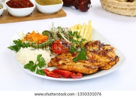 Delicious dishes from chicken thigh with rice and salad leaves Stock photo © vlad_star