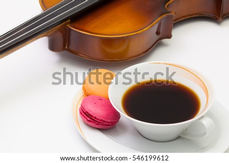 Old violin, cup of coffee and traditional french colorful macaro Stock photo © CaptureLight