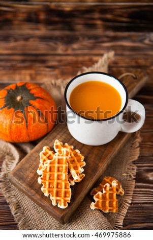 mug of fresh pumpkin juice with wafer and pumpkin on dark wooden stock photo © yatsenko