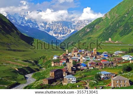 Kilátás magas hegy falu nyár tájkép Stock fotó © Kotenko