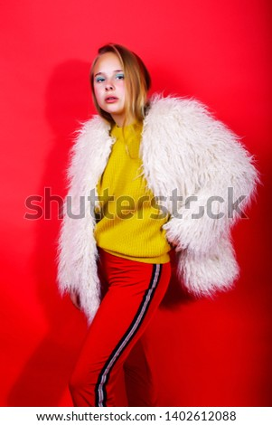 young pretty emitonal posing teenage girl on bright red background happy smiling lifestyle people c stock photo © iordani