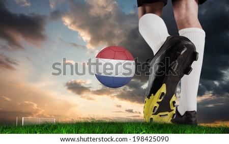 Soccer ball in goal net against digitally generated dutch national flag Stock photo © wavebreak_media