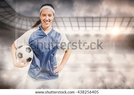 Woman soccer player smiling and posing with a ball  against digitally generated uruguay national fla Stock photo © wavebreak_media