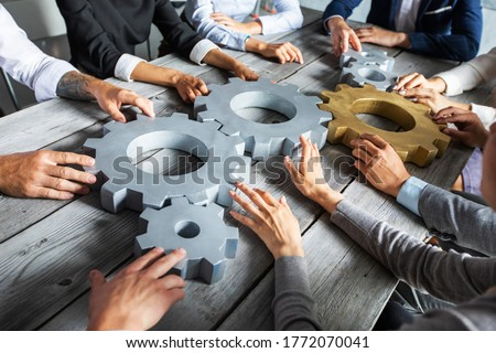 Equipe de negócios engrenagens trabalho em equipe integração dobrar Foto stock © alphaspirit
