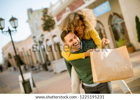 Young man holds young woman on his back , have fun and go to sho Stock photo © boggy