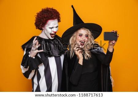 Foto glücklich Hexe Frau Mann tragen Stock foto © deandrobot
