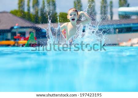 Vidám fiú gyerek ugrik medence víz sport Stock fotó © galitskaya