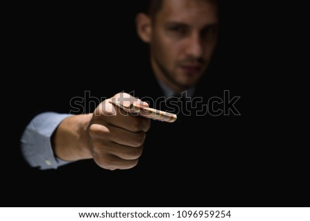 corrupted businessman or politician bribe in the form of hundre stock photo © snowing